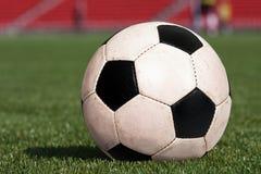 Soccer ball on stadium Stock Photos