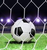 Soccer ball on stadium. Closeup soccer ball on green grass of stadium Royalty Free Stock Image