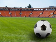 Soccer ball on stadium Stock Image