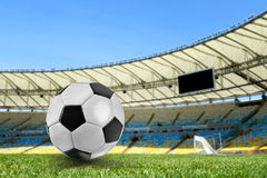 Soccer ball on the stadium Royalty Free Stock Image