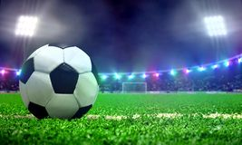 Soccer ball in a stadium field with spotlights Stock Photography