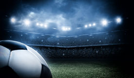 Soccer ball in the stadium Royalty Free Stock Image