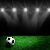 Soccer ball on the stadium lawn royalty free stock photography