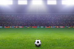 Soccer ball, stadium, light Stock Images