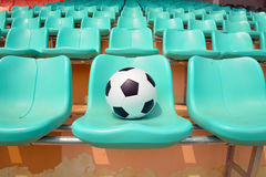 Soccer ball on stadium seat Royalty Free Stock Photography