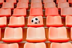 Soccer ball on stadium seat Stock Image