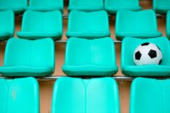Soccer ball on stadium seat Royalty Free Stock Photo