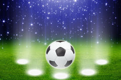 Soccer ball, stadium, spotlights Royalty Free Stock Images