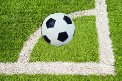 Soccer ball on the stadium in sunny day Royalty Free Stock Photo