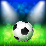 Soccer ball on stadium vector background Royalty Free Stock Image
