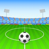 Soccer ball on stadium Royalty Free Stock Image