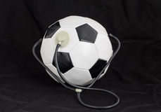 Soccer ball with stethoscope. Royalty Free Stock Photos