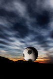 Soccer ball in sunset Stock Image