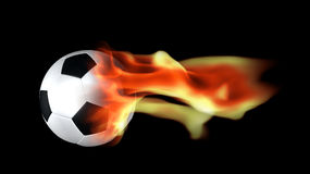 Soccer ball surrounded by flames Royalty Free Stock Photo