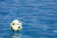 Soccer Ball in Swimming Pool Stock Photo