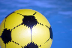 Soccer ball in swimming pool Royalty Free Stock Photos