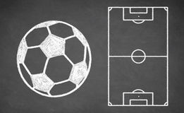 Soccer ball and tactical scheme on chalkboard. Royalty Free Stock Images