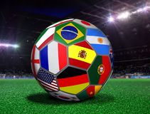Soccer Ball with Team Flags in a Stadium. At Night Stock Photo