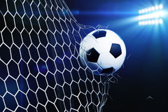 Soccer ball tearing and breaking football goal net. 3d illustration of soccer ball tearing and breaking football goal net. Stadium light background Stock Image