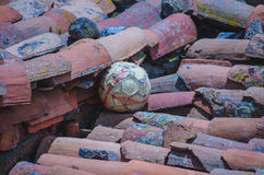 Soccer ball on a tiled roof Stock Photo