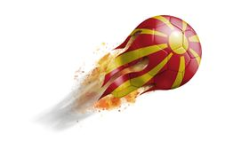 Flying Flaming Soccer Ball with Macedonia Flag. Soccer ball with a trail of smoke and flames flying through the air with flags from countries of the world Royalty Free Stock Photo
