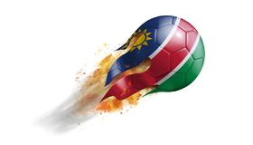 Flying Flaming Soccer Ball with Namibia Flag. Soccer ball with a trail of smoke and flames flying through the air with flags from countries of the world Royalty Free Stock Photo