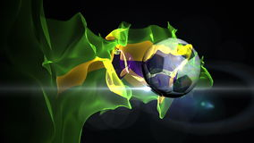 Soccer ball turns into the world with Brazil's flag stock video footage