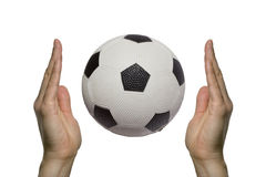 Soccer ball between two hands Royalty Free Stock Photography