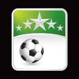 Soccer ball under green star backdrop Royalty Free Stock Images