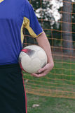 Soccer ball under player's arm Royalty Free Stock Images