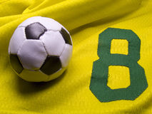 Soccer ball and uniform. Photo of the soccer ball over nuber eight uniform Stock Image