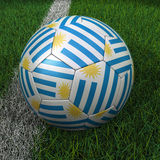 Soccer Ball with Uruguay Flag Royalty Free Stock Image