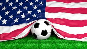 Soccer ball with Usa flag on football field. Closeup Stock Photos