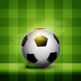 Soccer ball on wallpaper. Soccer ball on the green field pattern wallpaper Royalty Free Stock Photos