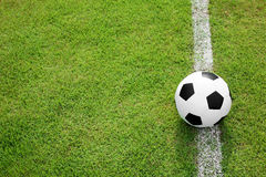 Soccer ball on white line Royalty Free Stock Photo