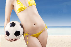 Soccer ball in woman hands Royalty Free Stock Photos