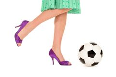 Soccer Ball and Women's Legs Royalty Free Stock Photos