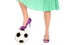 Soccer Ball and Women's Legs Stock Image
