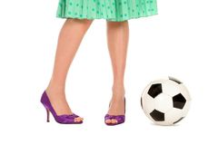 Soccer Ball and Women's Legs Stock Photography