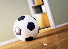Soccer ball on wood floor Royalty Free Stock Photography