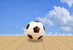 Soccer Ball on wood floor with  blue sky Royalty Free Stock Photography