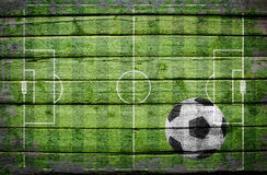 Soccer ball on wooden surface Royalty Free Stock Photo