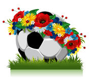 Soccer ball in a wreath of flowers Stock Images