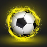 Soccer ball in yellow flame Stock Photography