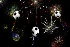 Soccer Balloons. Soccer ball balloons and fireworks in the night sky Stock Photography