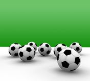 Soccer balls. With green background - 3d illustration Royalty Free Stock Photography