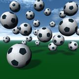 Soccer balls. A lot of soccer balls on green - 3D rendering Stock Images