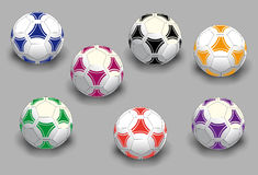 Soccer balls. Seven isolated soccer balls in different colors combinations. Vector illustration Stock Image