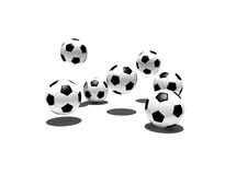 Soccer balls in the air Stock Images