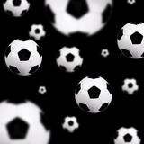 Soccer balls background. Soccer balls on black background Royalty Free Stock Photos
